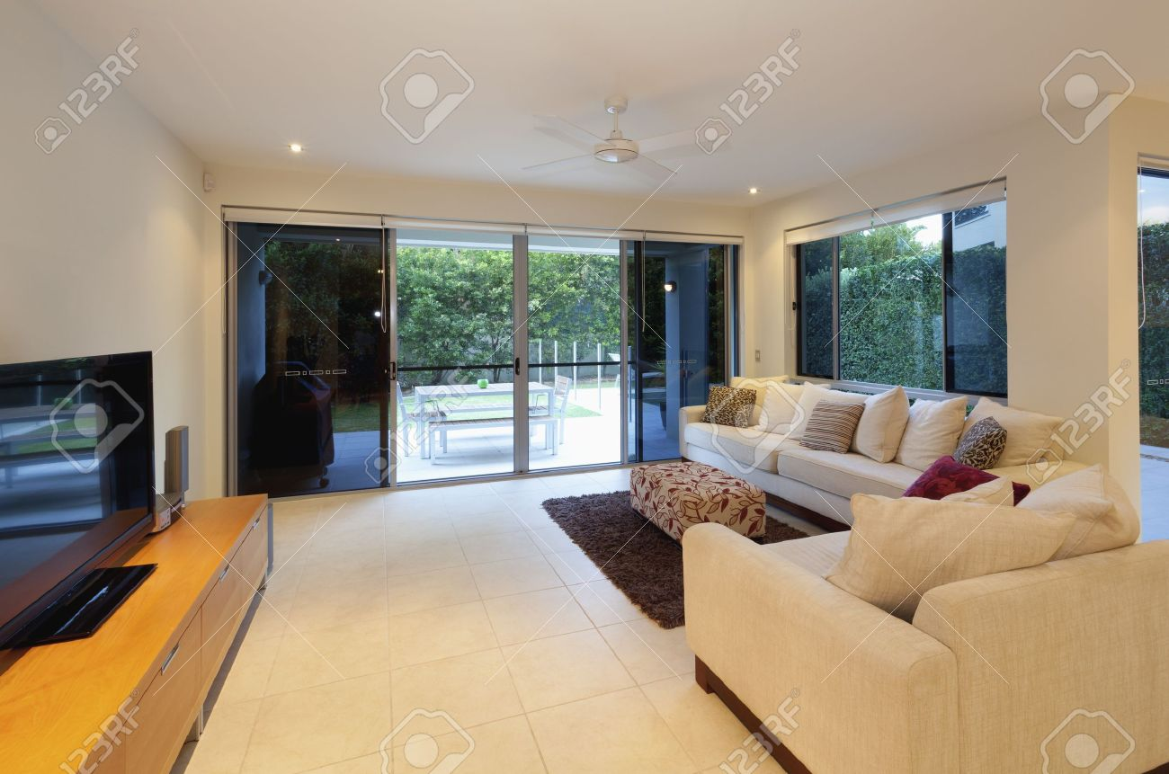 Modern mansion living room with tv - Stylish Living Room With Couch And Tv In Modern House Stock Photo 13723867