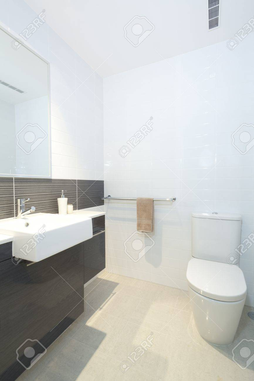 Small Modern Bathroom With Toilet, Sink And Mirror Stock Photo ...