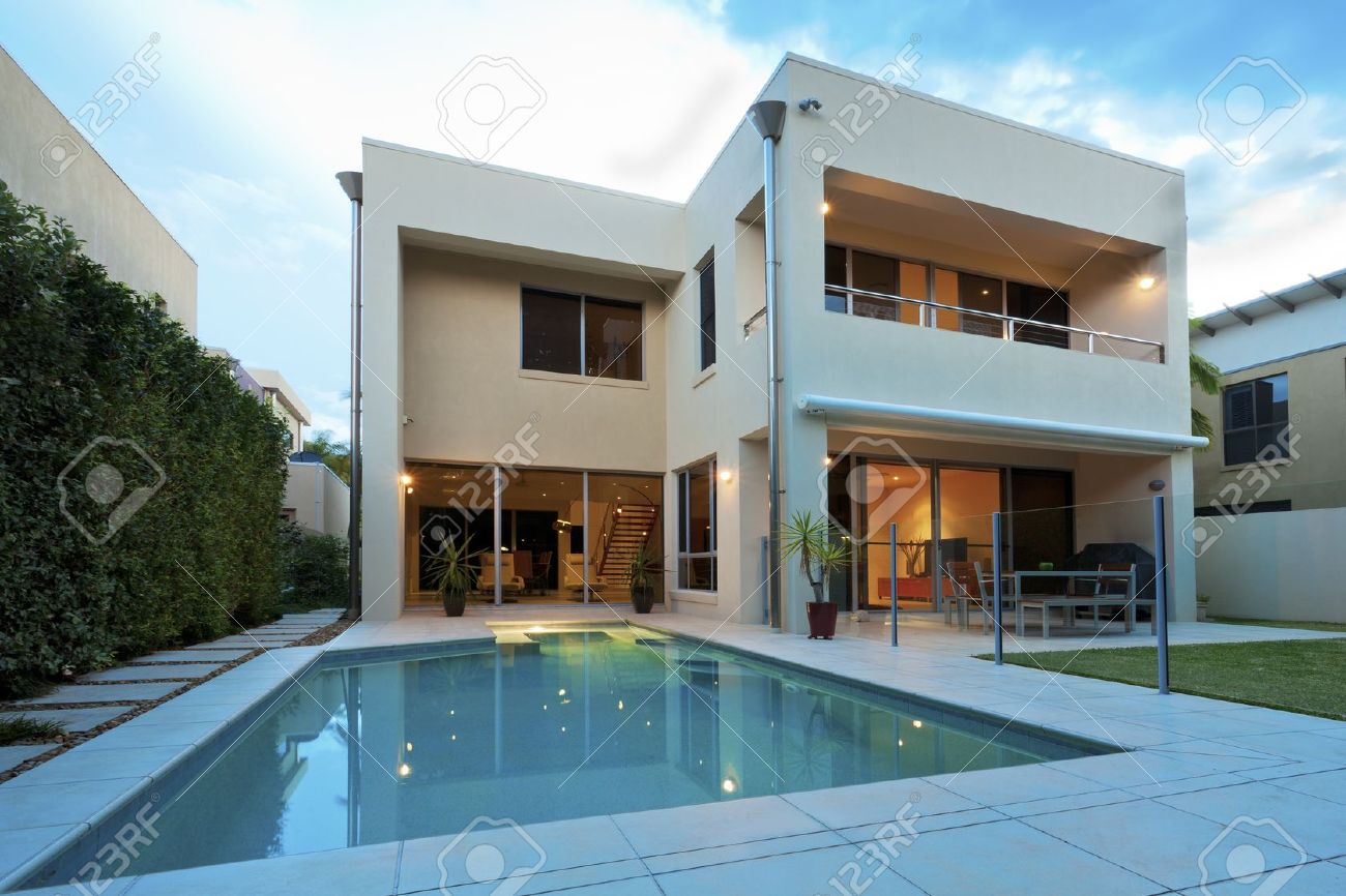 Luxurious Modern House With Swimming Pool And Backyard Stock Photo ...