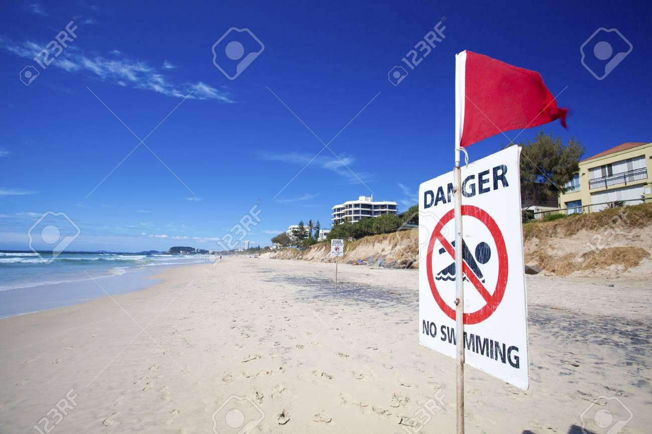 Danger no swimming sign on eroded Australian beach Stock Photo - 16834713