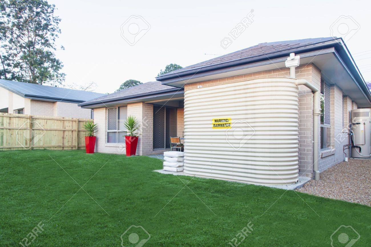 backyard with water tank of australian townhouse stock photo