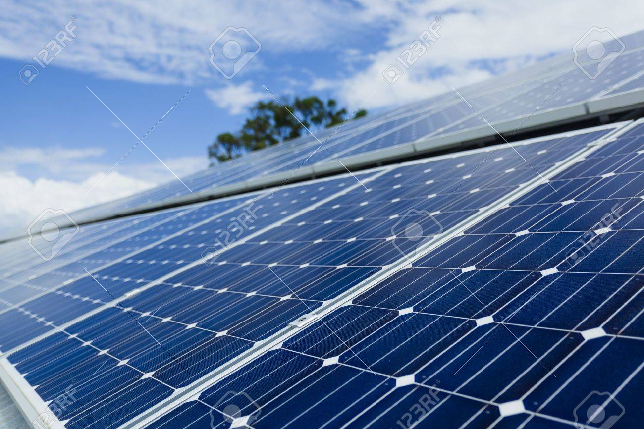 Solar panels on factory roof Stock Photo - 18437262