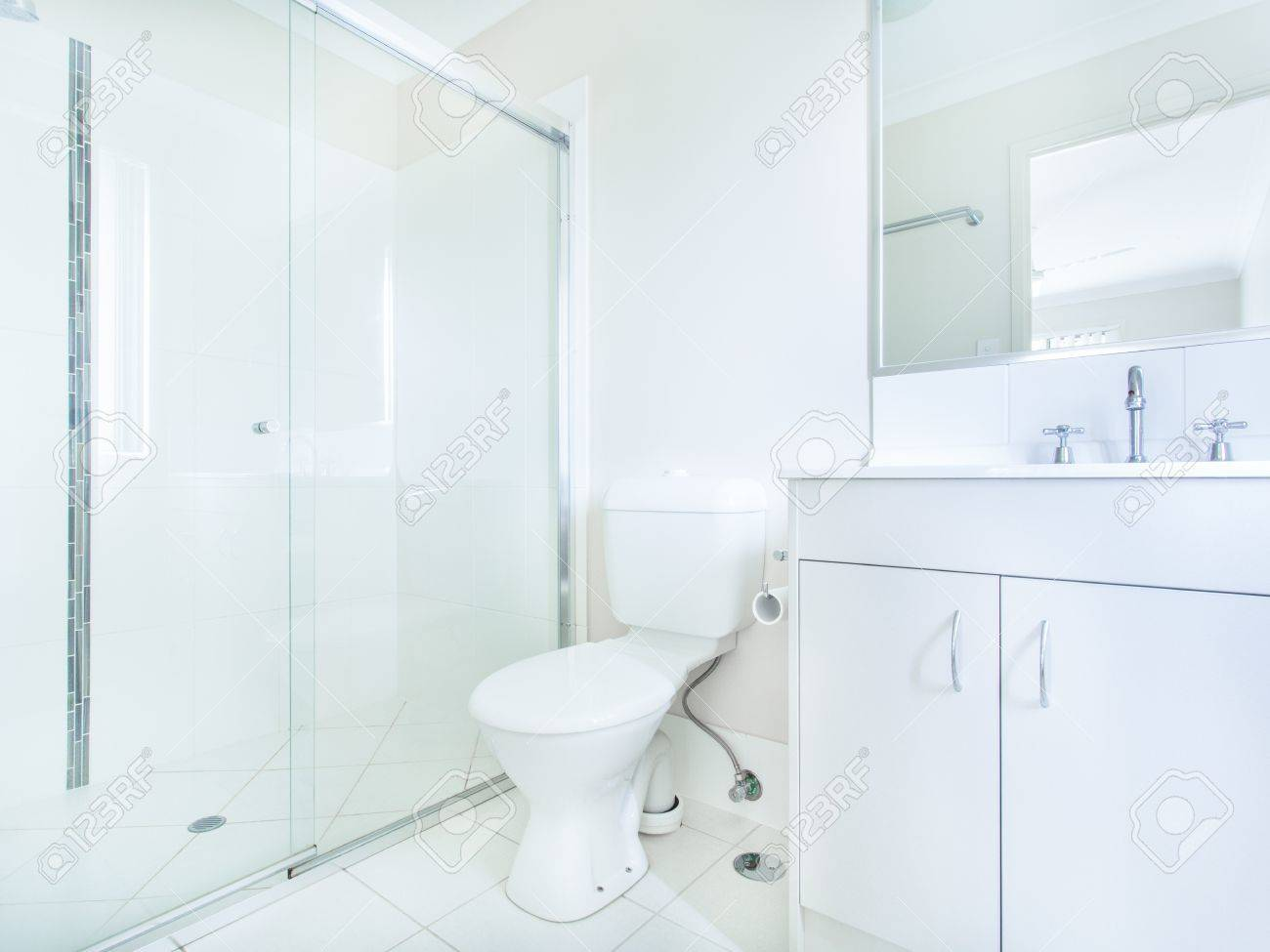 Simple bathroom shower - Simple Bathroom With Sink Mirror Toilet And Shower Stock Photo 18456135