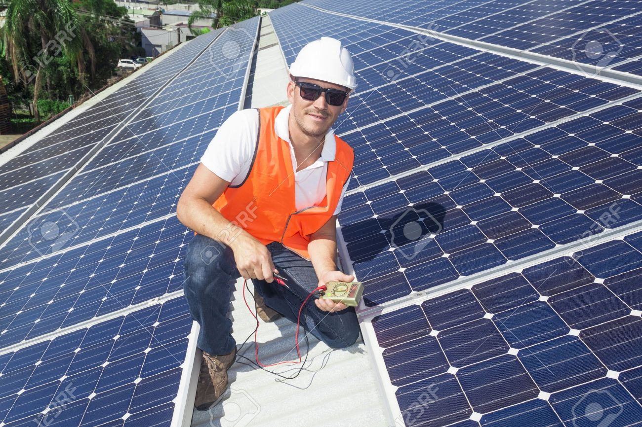 Young Technician Installing Solar Panels On Factory Roof Stock Photo    19378347