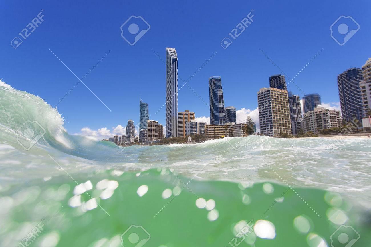 Waves rolling on Surfers Paradise beach on Gold Coast, Australia Standard-Bild - 26040386