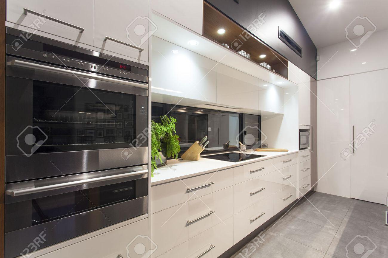 New LED lit modern kitchen in stylish home Standard-Bild - 34236524