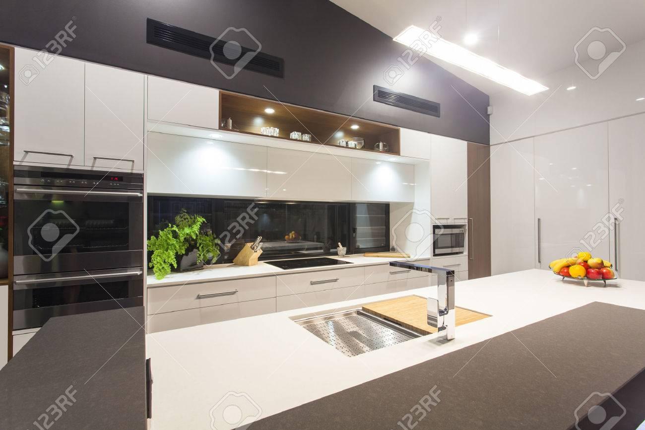 New LED lit modern kitchen in stylish home Standard-Bild - 34236525