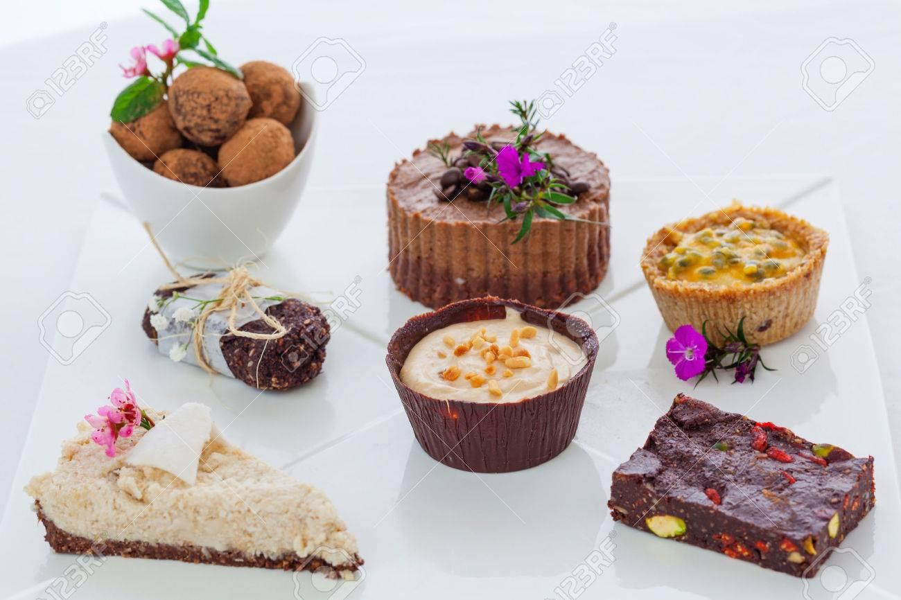 Mixed plate of healthy raw vegan desserts Standard-Bild - 34434998