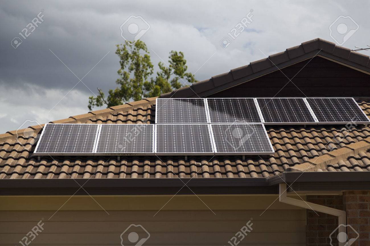 Solar photovoltaic panels installed on tiled roof Standard-Bild - 36454434