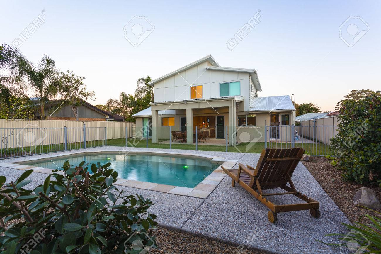 Modern home exterior with pool at dusk Standard-Bild - 36454966