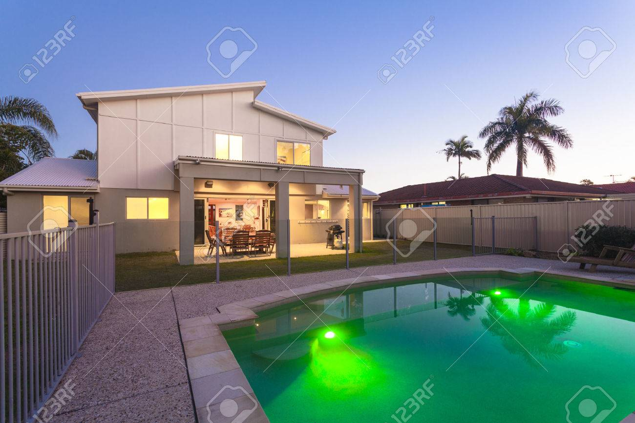 Modern home exterior with pool at dusk Standard-Bild - 36454968
