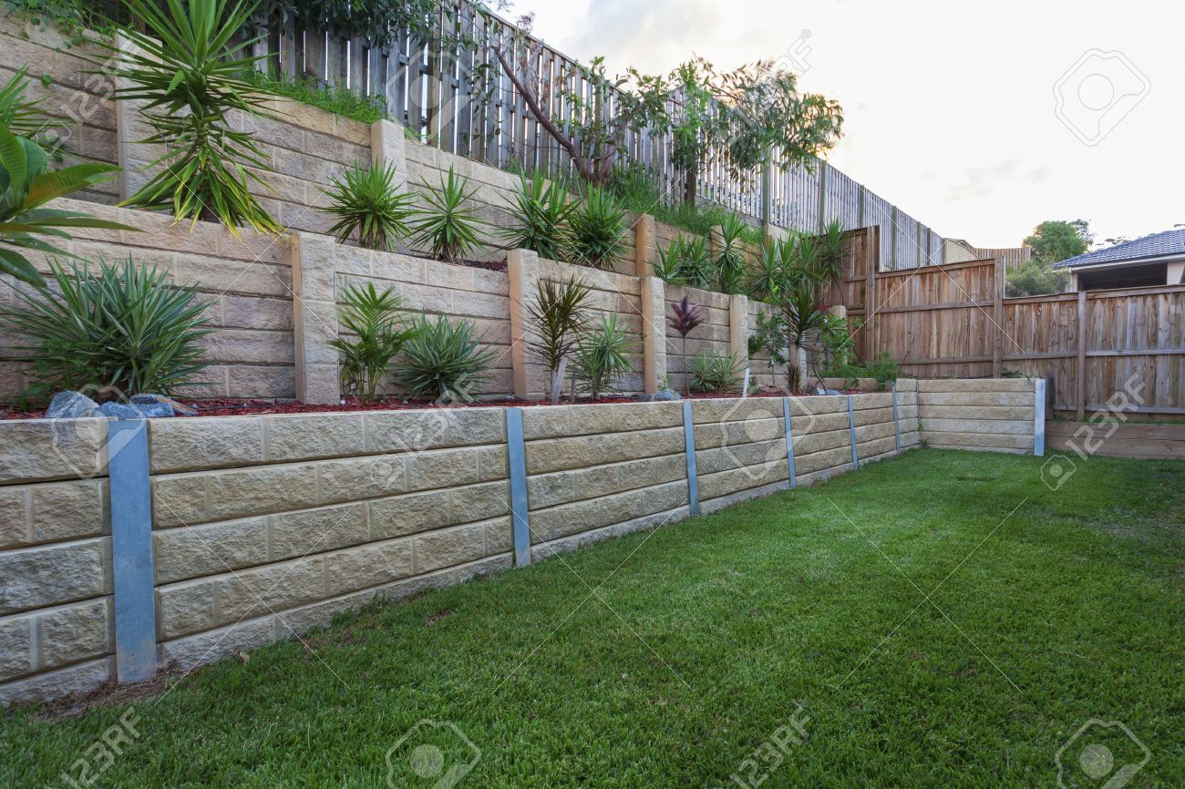 Multi level retaing wall with plants in backyard Standard-Bild - 37743221