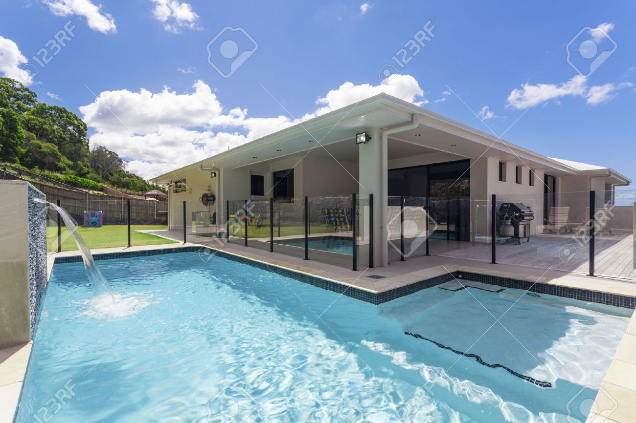 Stylish home backyard with swimming pool Standard-Bild - 55433969