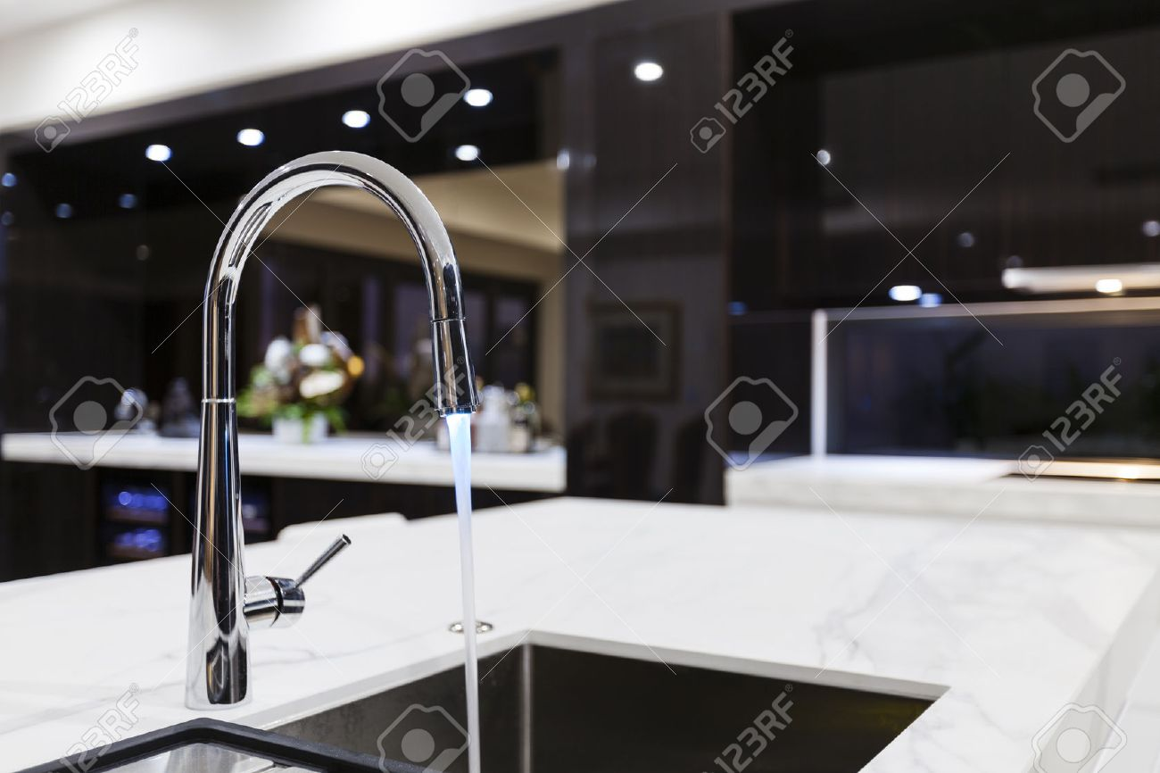 Modern kitchen faucet with LED light Standard-Bild - 55434151