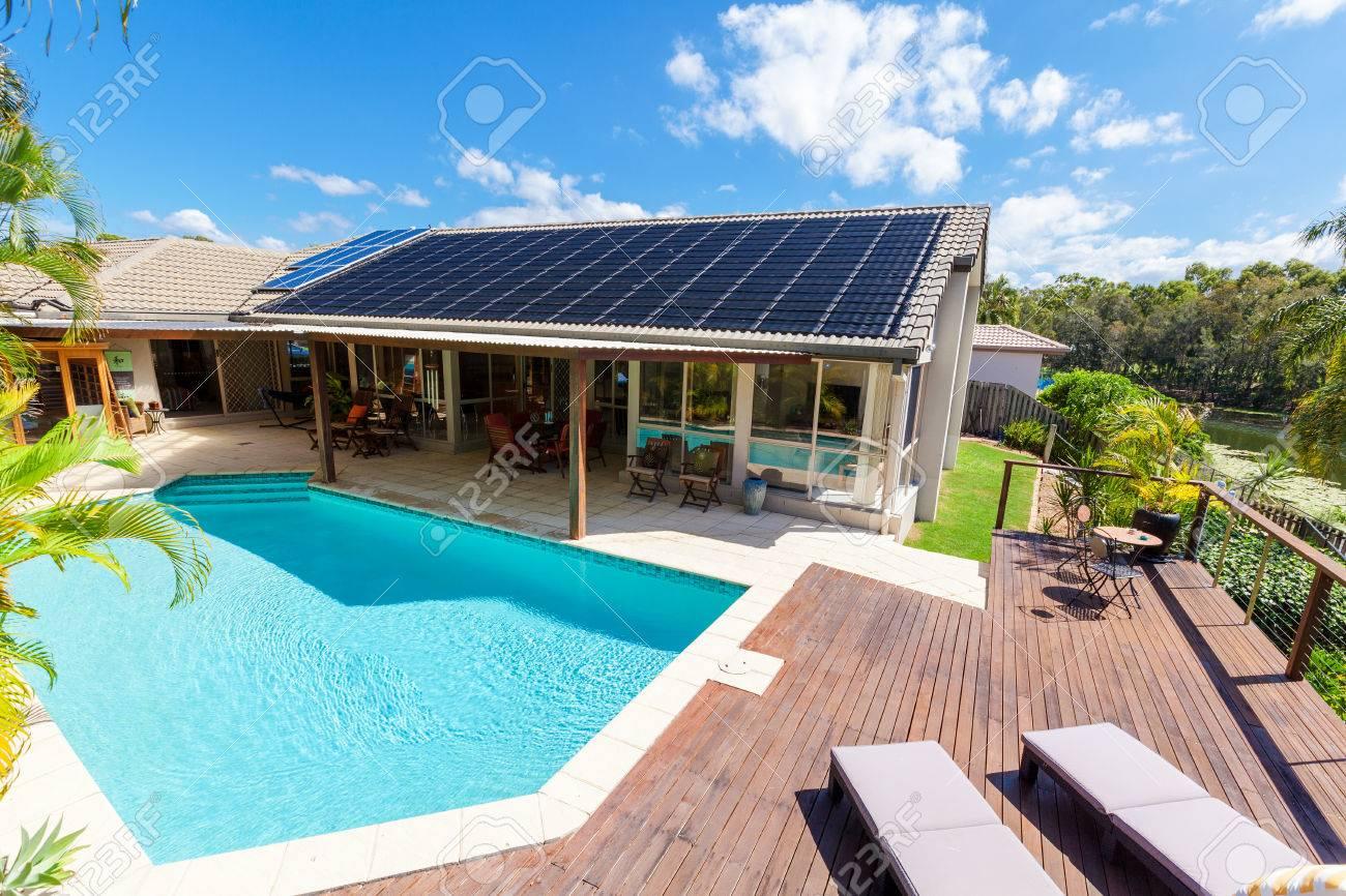 Backyard with swimming pool in stylish home Standard-Bild - 65805833