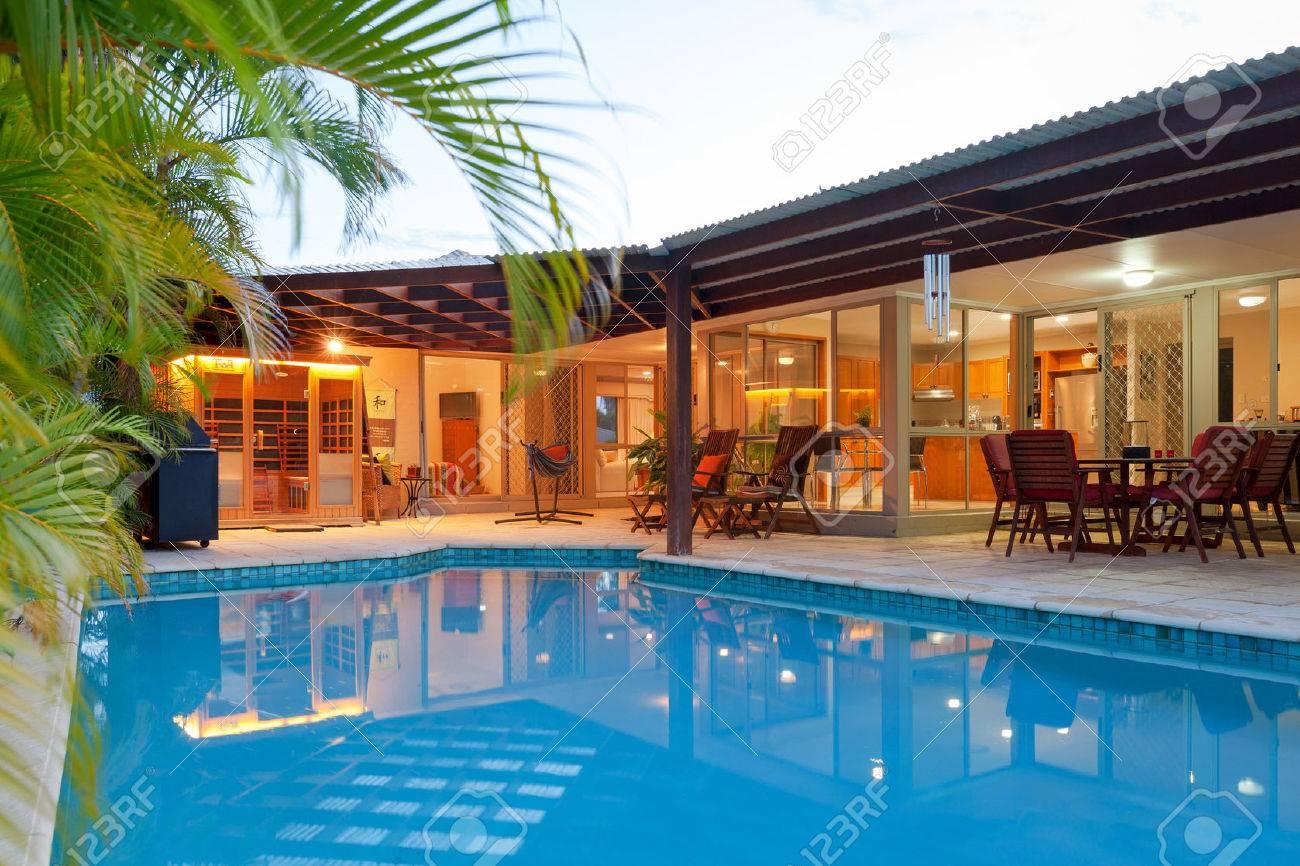 Backyard with swimming pool in stylish home Standard-Bild - 65841456