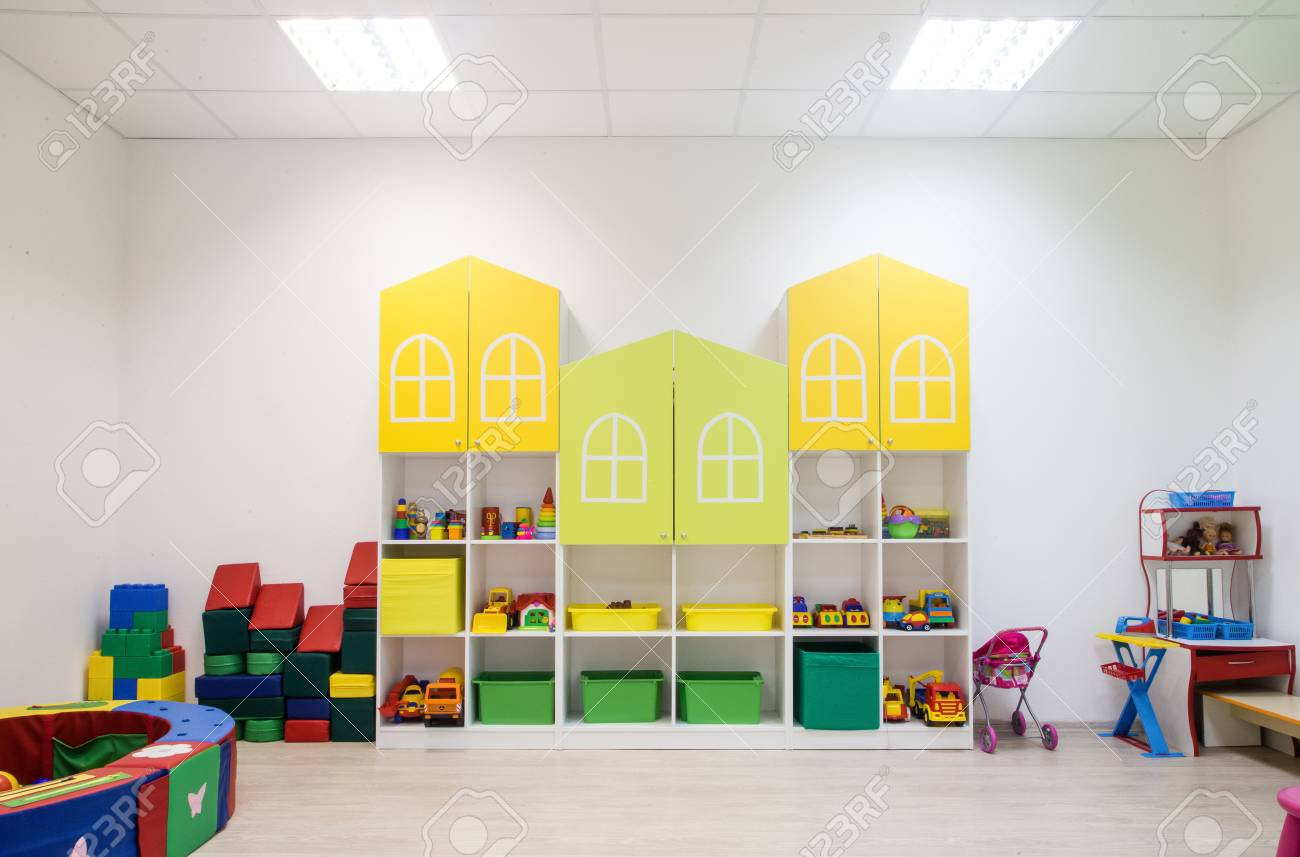 Light interior of a modern kindergarten in yellow and green colors
