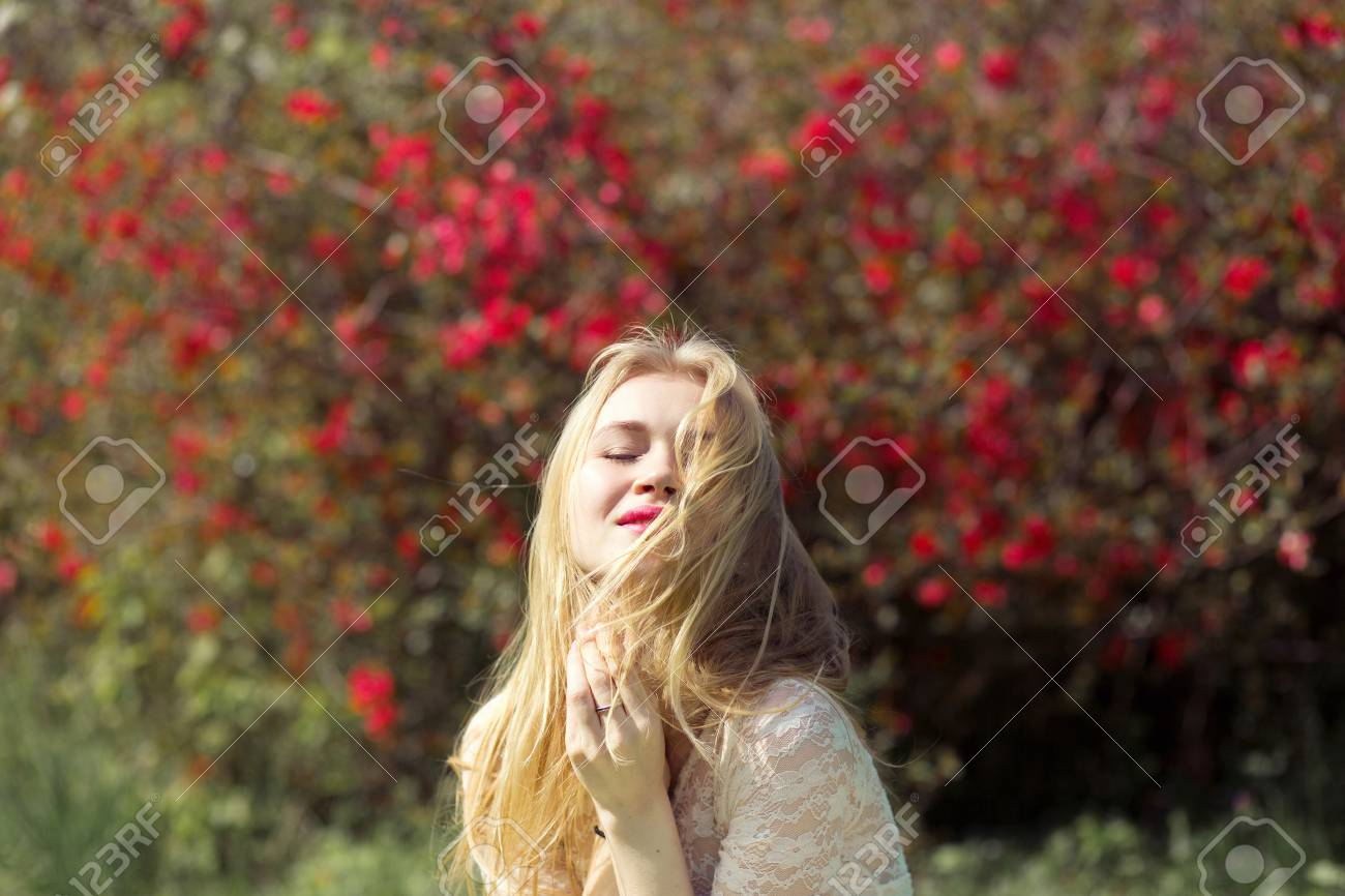 Blonde Young Woman In Spring Garden. Girl With Perfect Natural ...