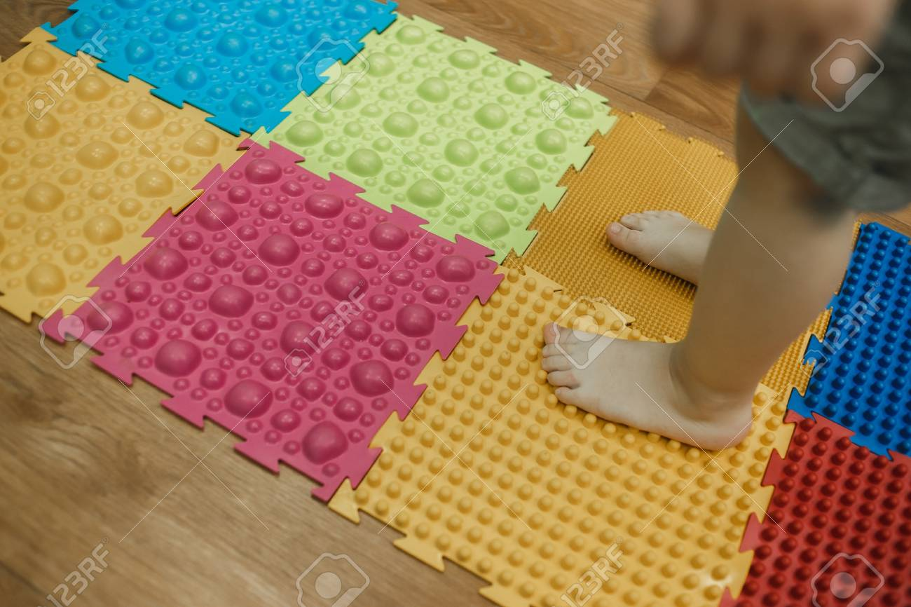 46a6bf086 Toddler On Baby Foot Massage Mat. Exercises For Legs On Orthopedic ...