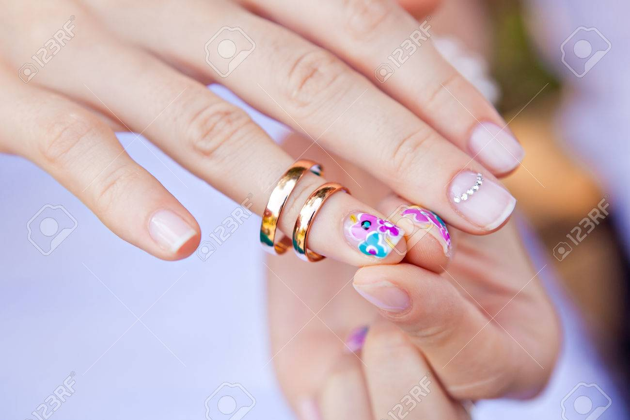 Wedding Ring On The Finger Of A Bride With A Colored Nail Polish ...