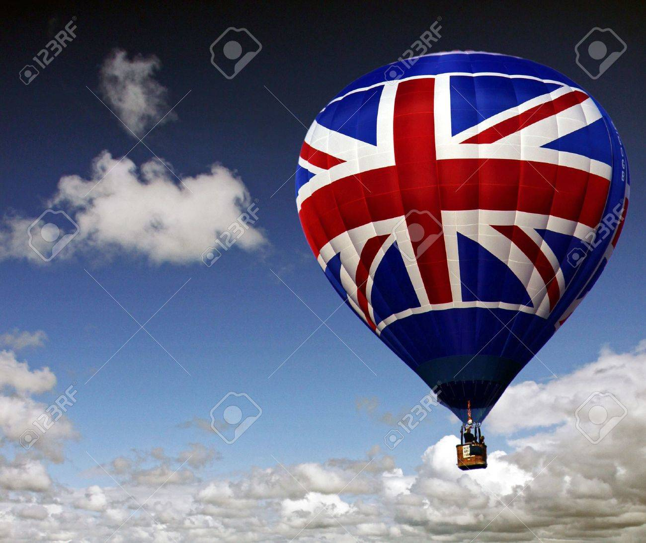 Colouful red white and blue hot air balloon rising in a cloudy sky Stock Photo - 5708687