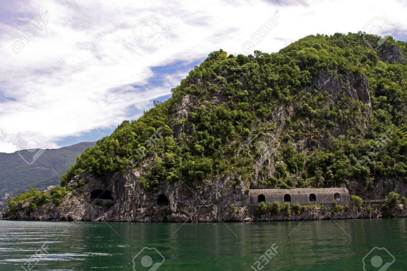 7073855-View-of-tree-covered-mountains-train-tunnel-and-Lake-Como-in-Italy-Stock-Photo.jpg