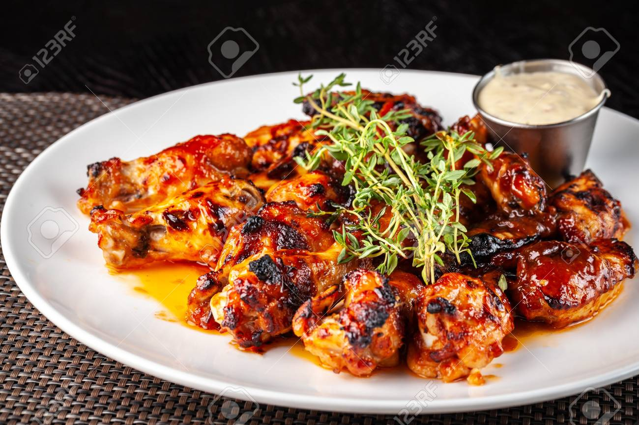 Mexican Cuisine Fried Chicken Wings In Glazed Hot Sauce With