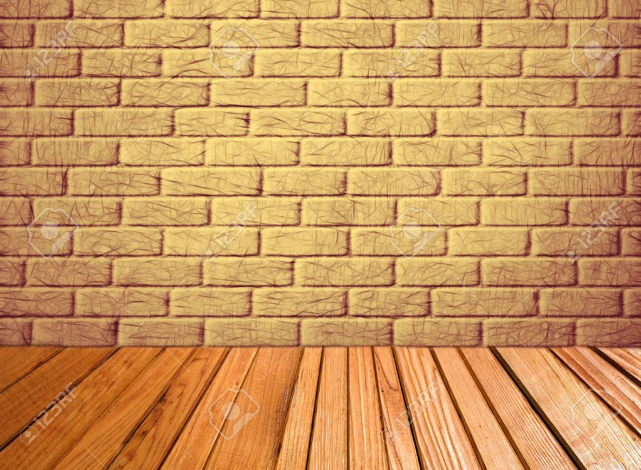 indoor hintergrund mit gelben backsteinmauer und holzdielenboden der