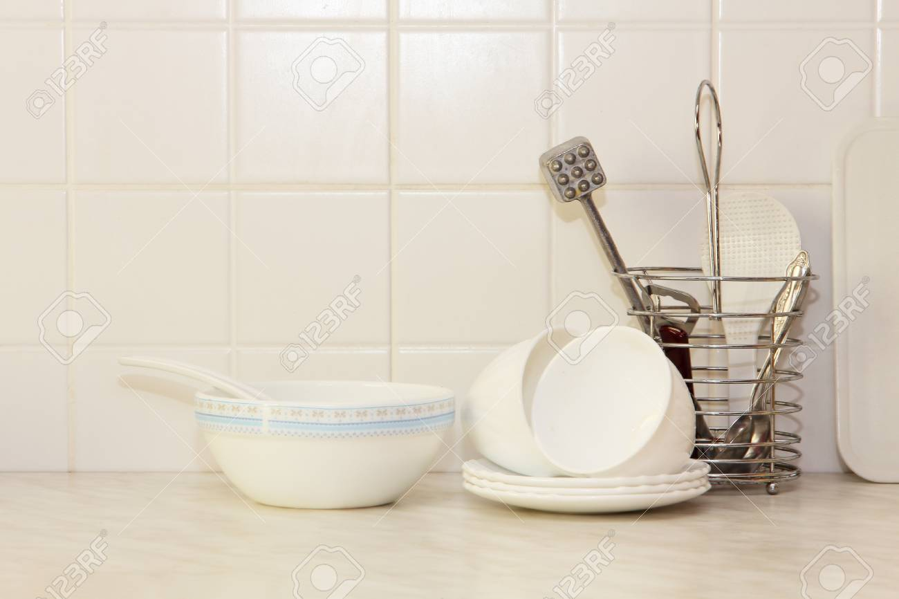 White Kitchenware On Kitchen Table And Ceramic Tile Background ...