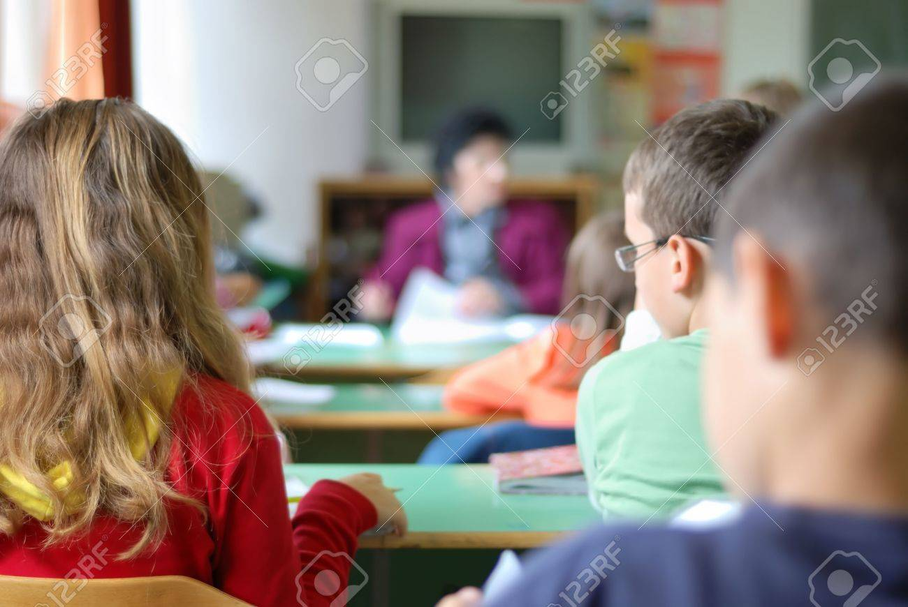 Kids in classroom studying, photographed from behind Stock Photo - 5100444