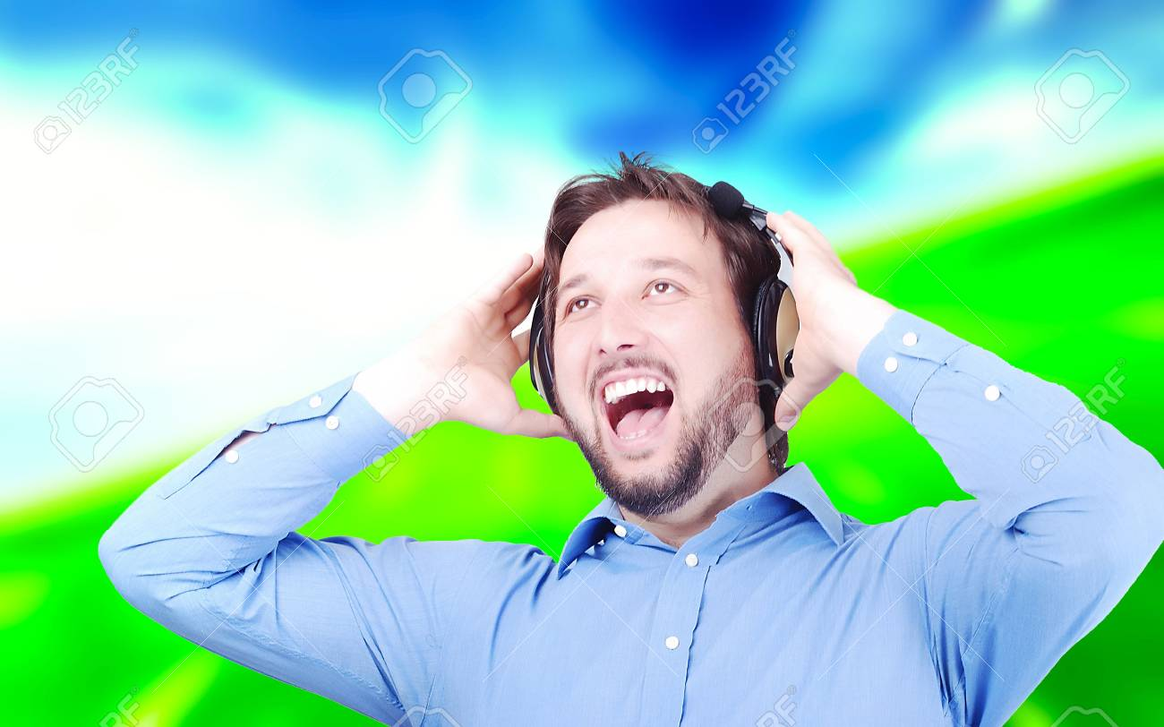 Happy man listening to music with headset on Stock Photo - 5152718