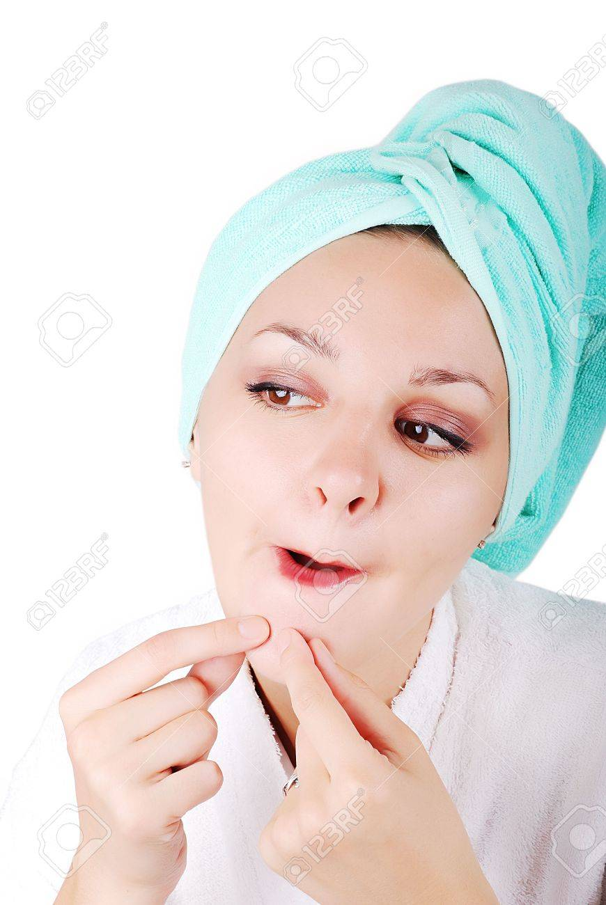 A pretty girl finding an acne on her chin Stock Photo - 5235180