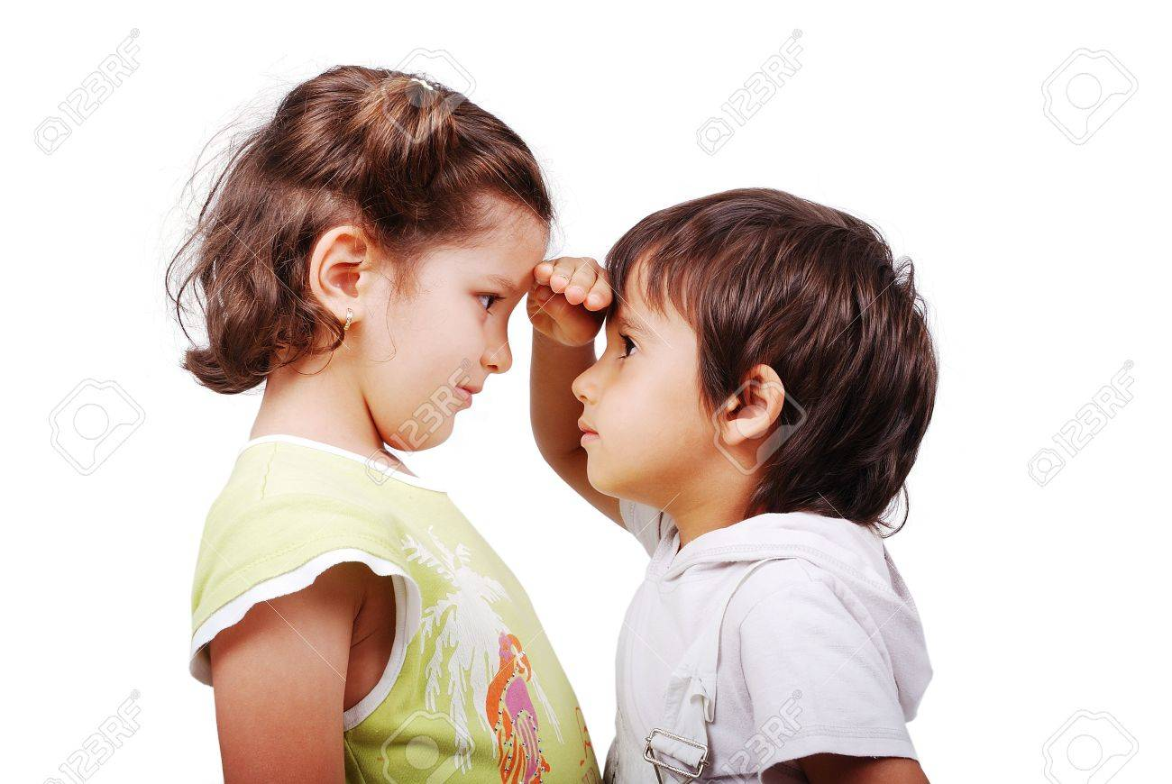 A little cute boy is measuring his height compared to girl Stock Photo - 5483180