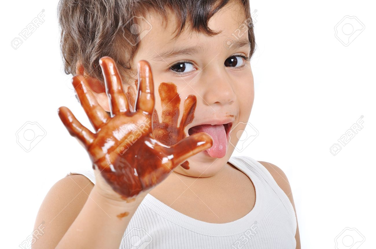 Little Cute Kid With Chocolate On Face And Hands Stock Photo ...