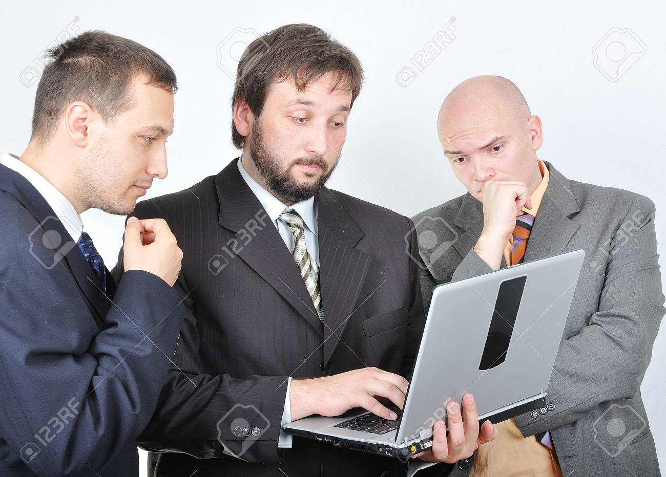 Group of three young businessmen on laptop Stock Photo - 5678829