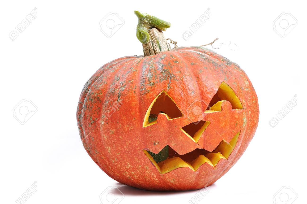 The carved face of pumpkin glowing on Halloween Stock Photo - 5730814
