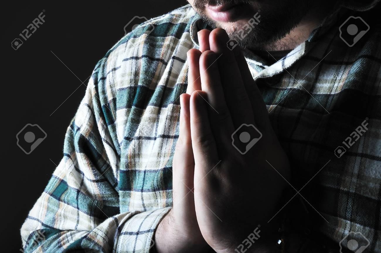 Man praying in the dark Stock Photo - 5973136