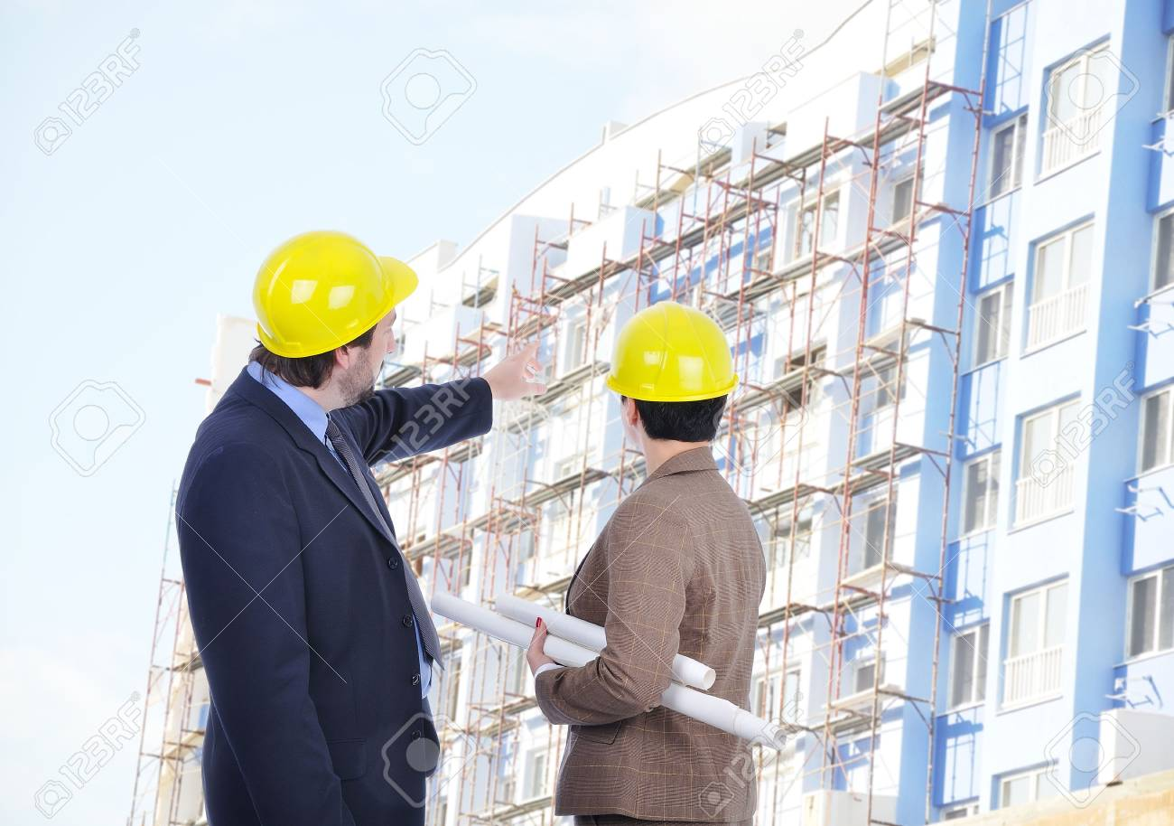 Two young engineers with blueprints Stock Photo - 6011914
