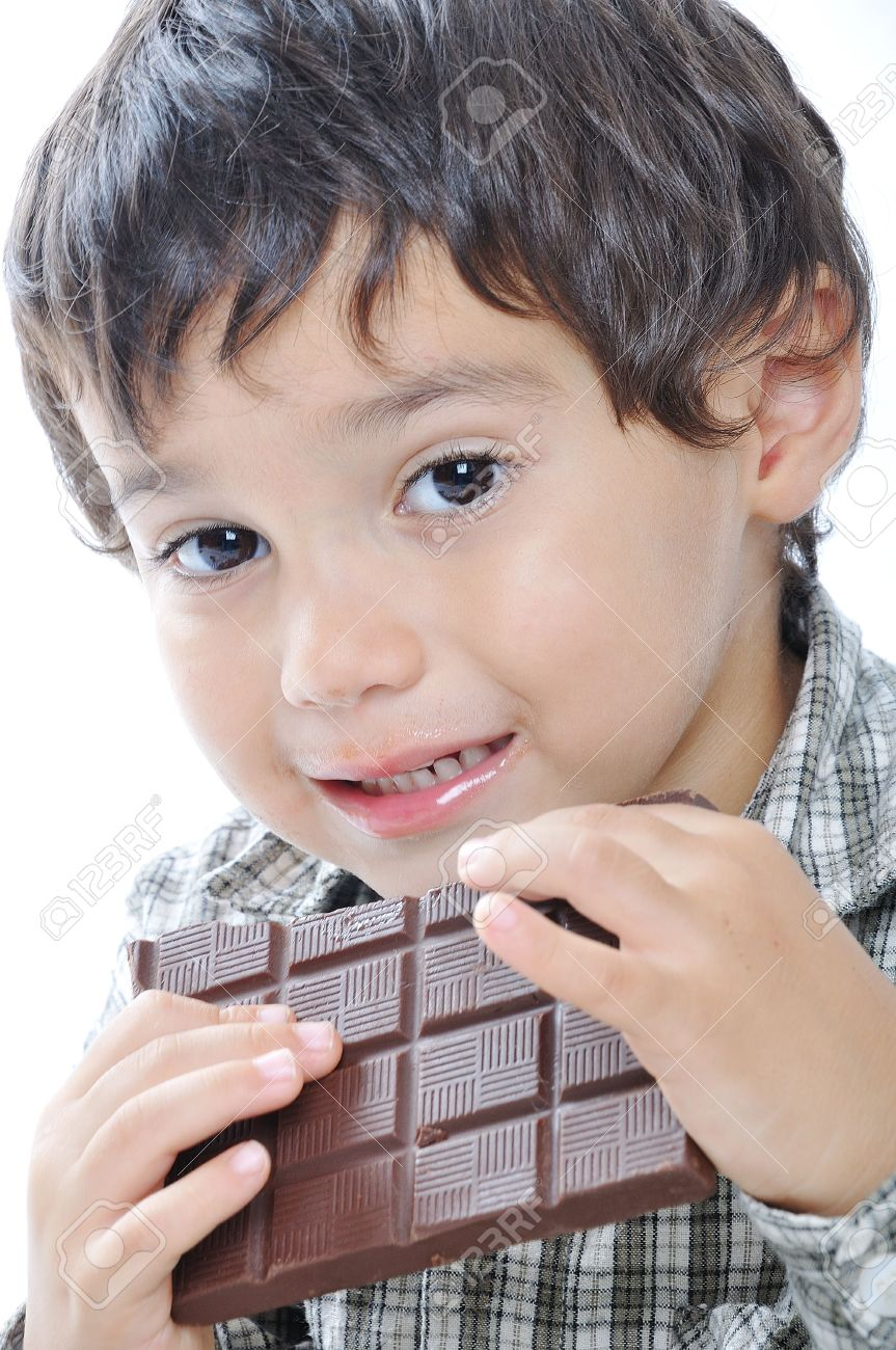 cute kid eating chocolate stock photo, picture and royalty free
