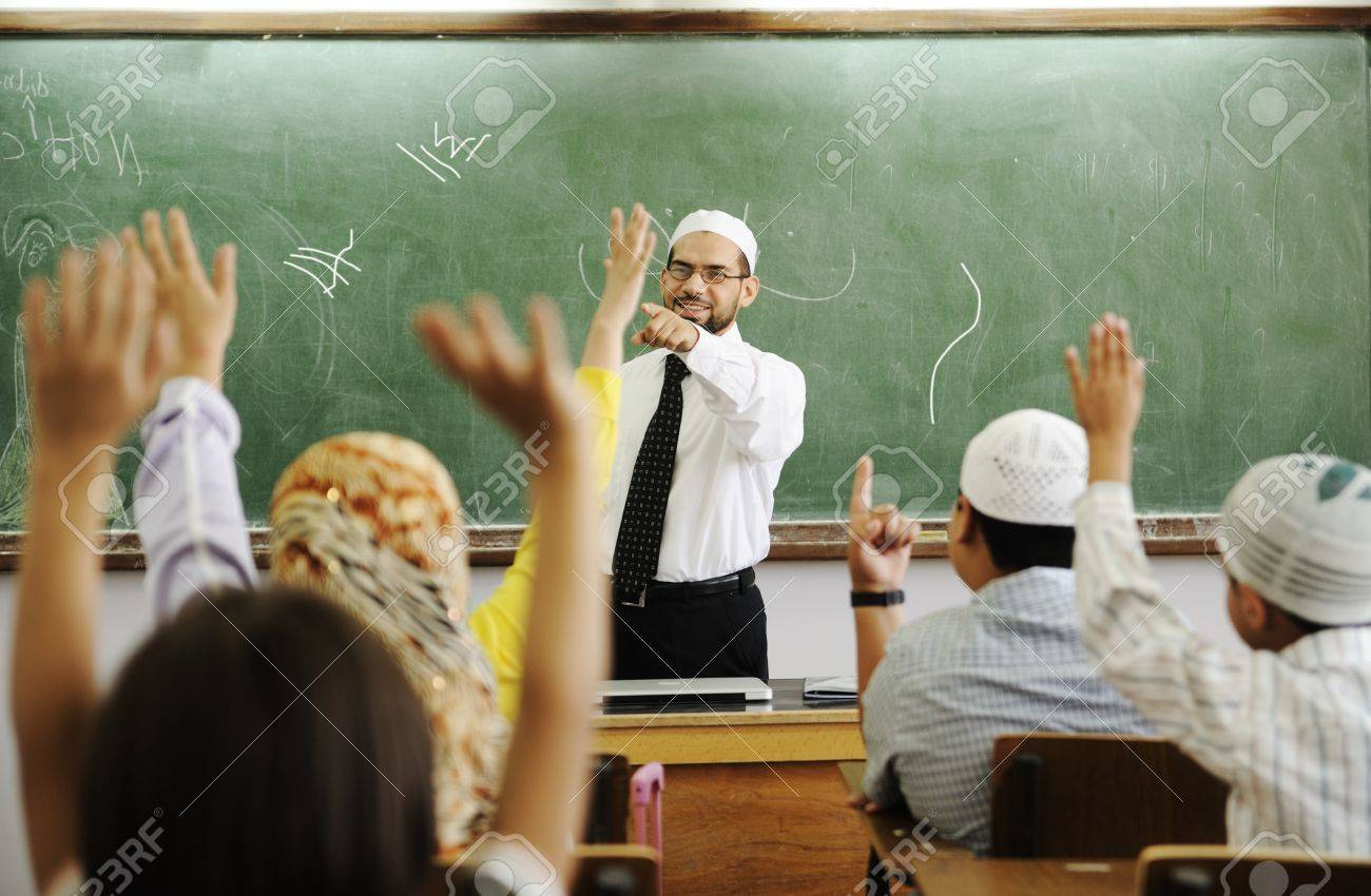Teacher with children in classroom, boys and girls in school together learning, competition Stock Photo - 8804960