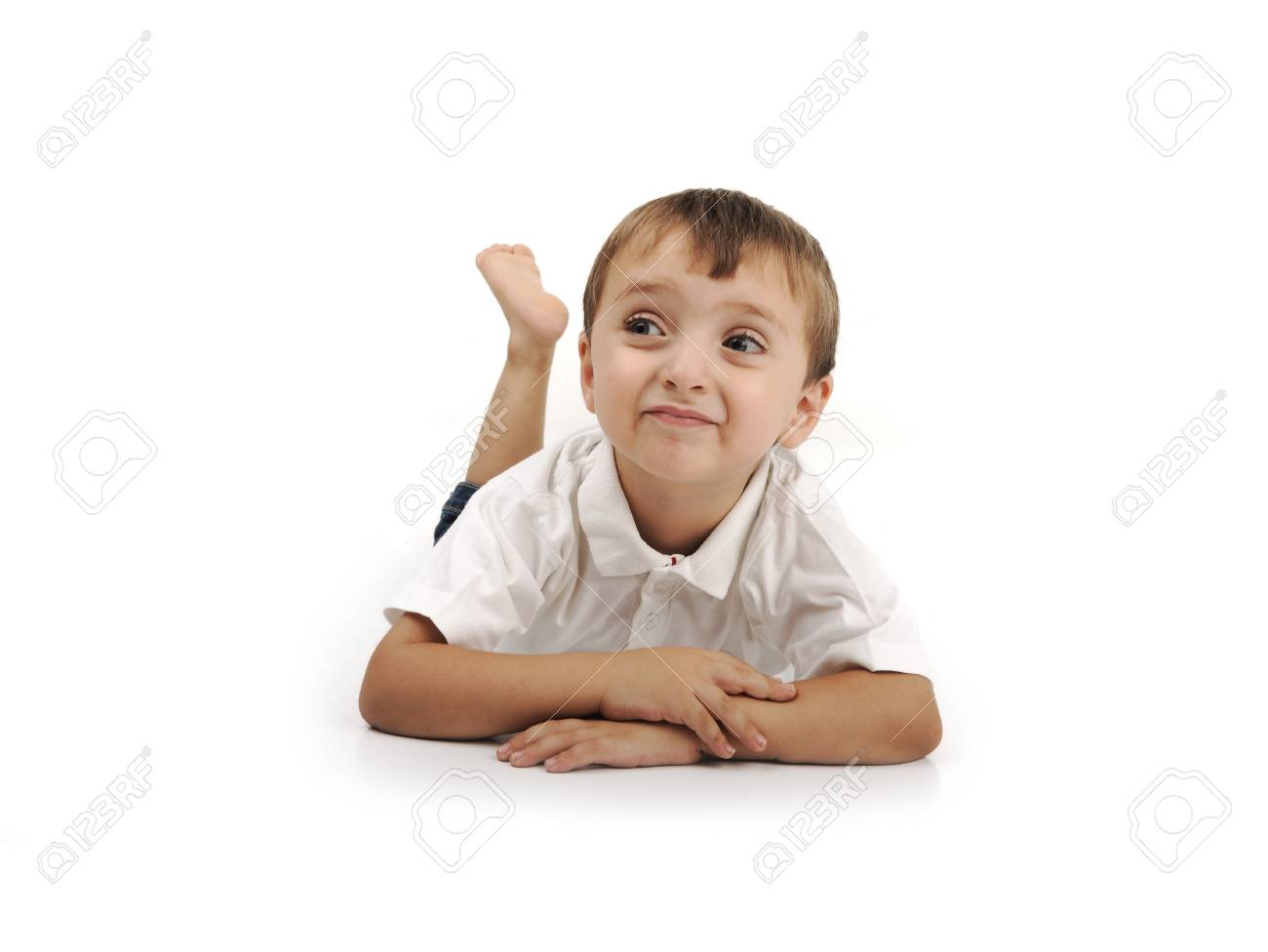 Very cute positive smiling little boy, isolated. Stock Photo - 8805757