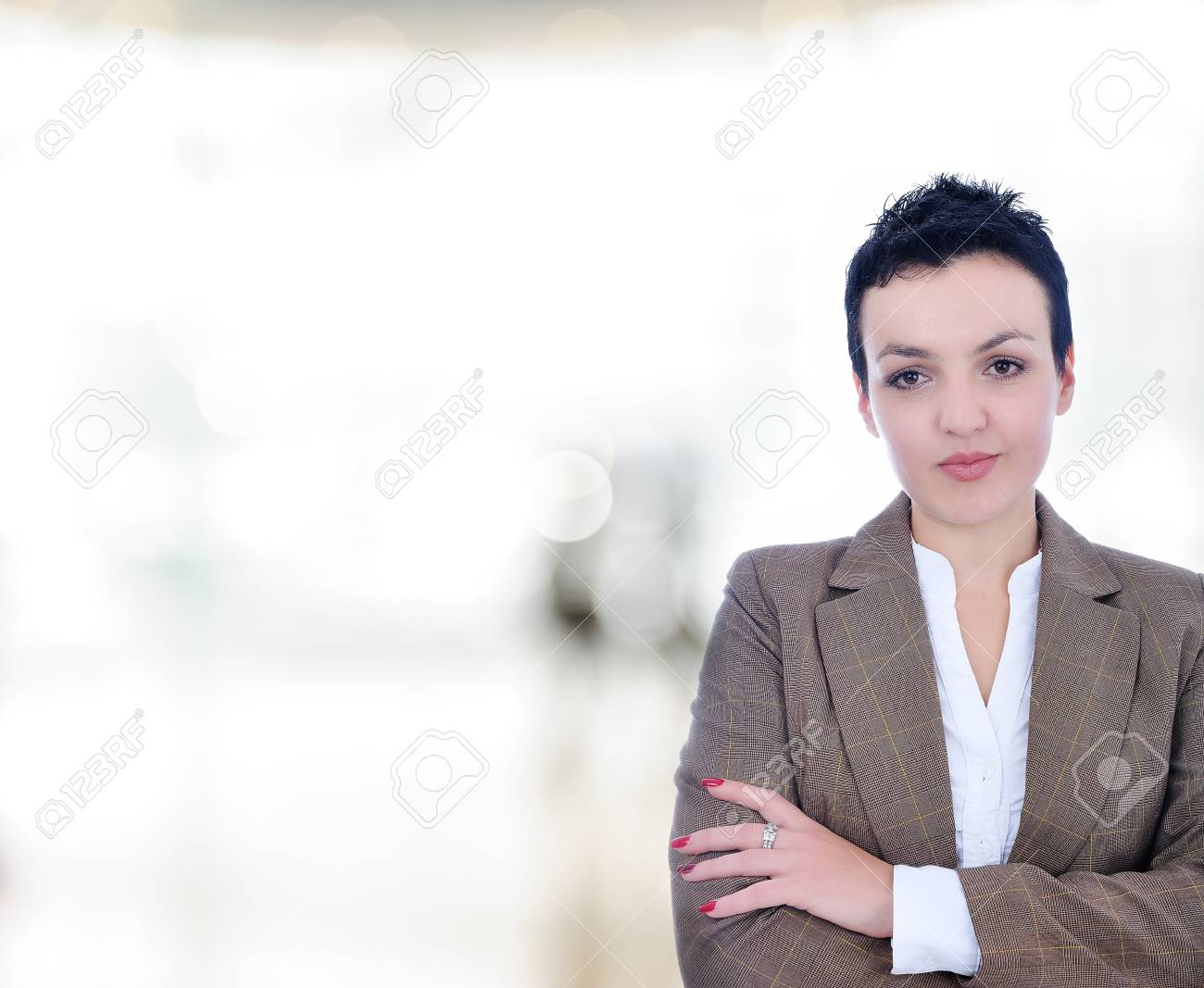 Closeup portrait of cute young business woman smiling in modern bright building Stock Photo - 9208170