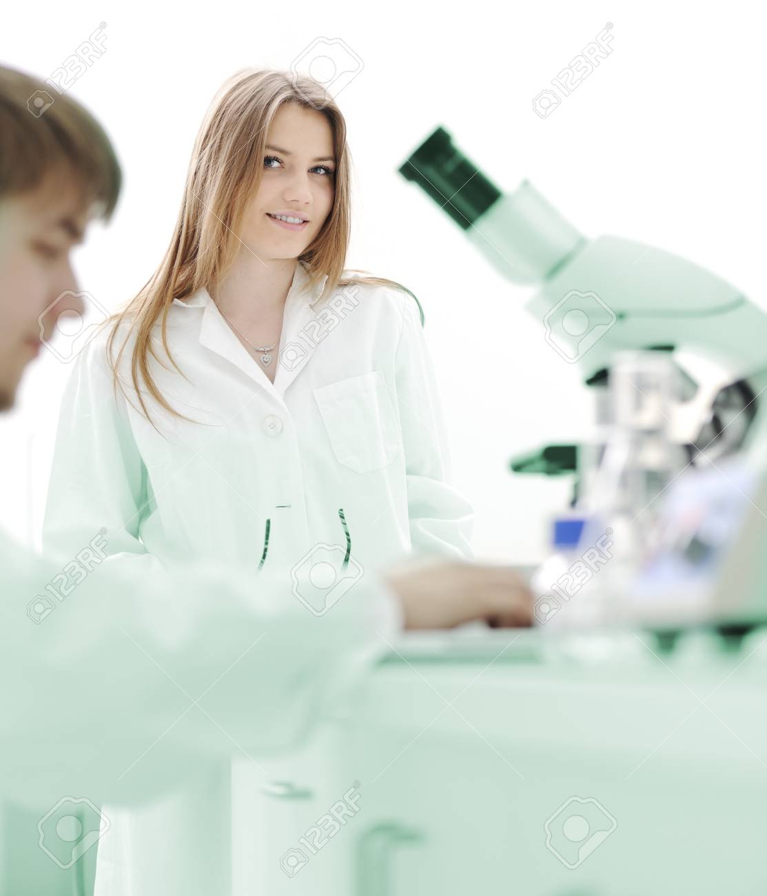 Two female scientists working at the laboratory with microscope Stock Photo - 10087006