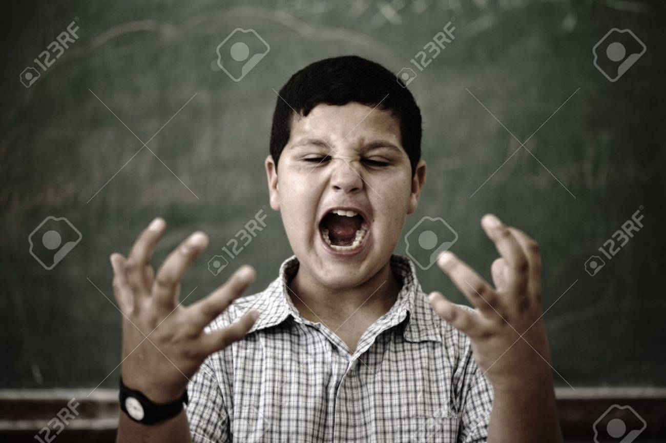 Furious mad pupil at school yelling Stock Photo - 10290812
