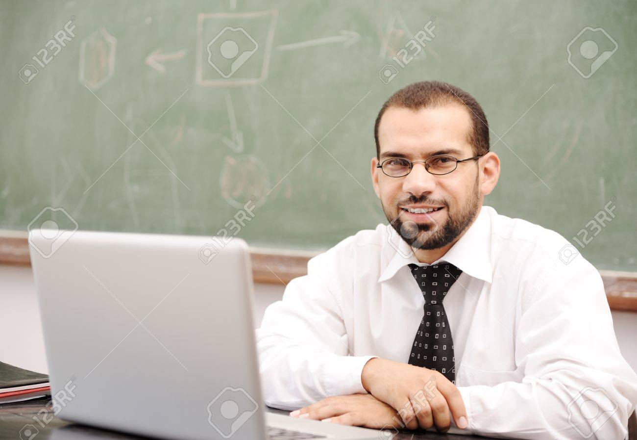 Education activities in classroom at school, Happy teacher with laptop Stock Photo - 10290223
