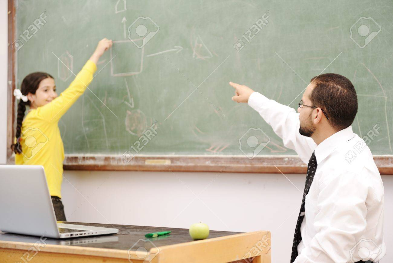 Education activities in classroom at school, happy children learning Stock Photo - 10290181