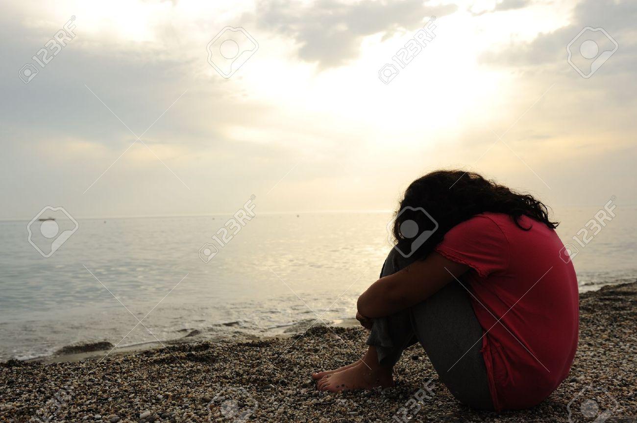 Lonely sad girl on the dark beach stock photo 10317037