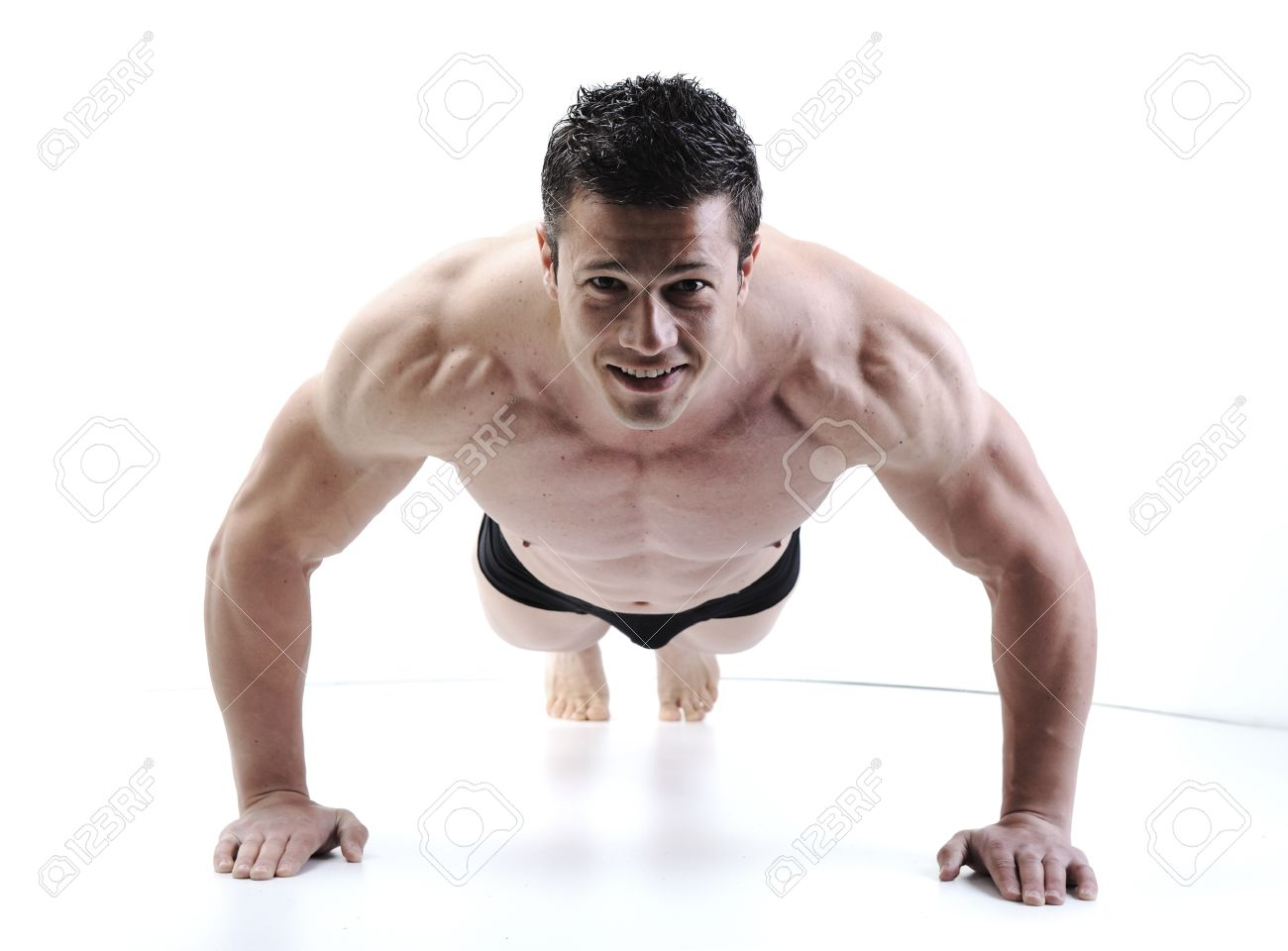 The Perfect male body - Awesome bodybuilder posing Stock Photo - 10316913