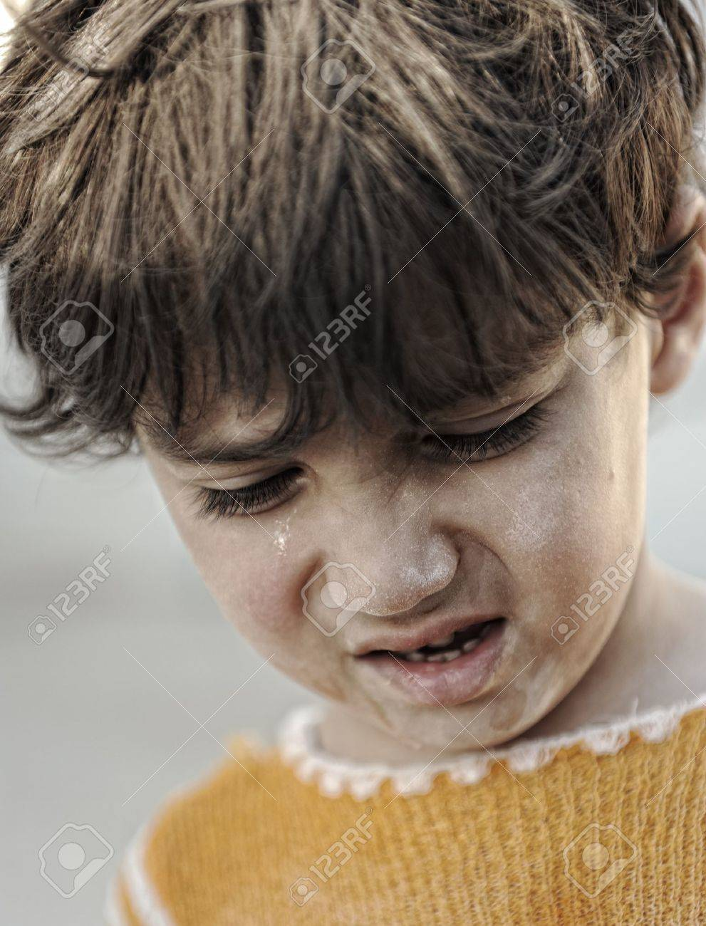 portrait of poverty little boy with sad look stock photo picture