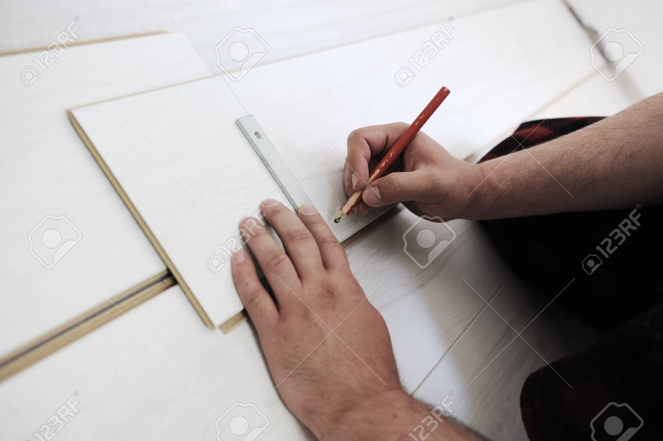Precise drawing and measuring on floor Stock Photo - 10680524